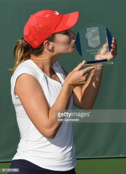 Danielle Collins stands with the women's championship trophy after defeating Sofya Zhuk in a three set finals match of the Oracle Challenger Series...