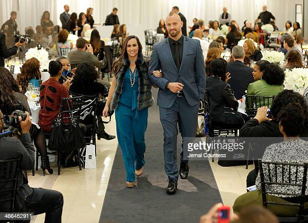 Danielle Conti and Mark Herzlich walk the runway at the Saks Fifth Avenue And Off The Field Players' Wives Association Charitable Fashion Show on...