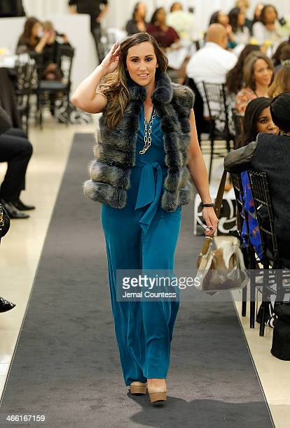 Danielle Conti walks the runway at the Saks Fifth Avenue And Off The Field Players' Wives Association Charitable Fashion Show on January 31 2014 in...