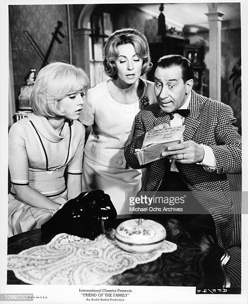 Danielle Darrieux and Sylvie Vartan looks as Pierre Dux reads the letter in a scene from the film 'Friend Of The Family' 1964