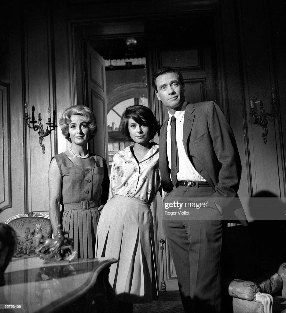 Danielle Darrieux, Catherine Deneuve and Mel Ferrer on the shooting of Jacques-Gerard Cornu's film ' L'Homme a femmes '. On 1960. ADR