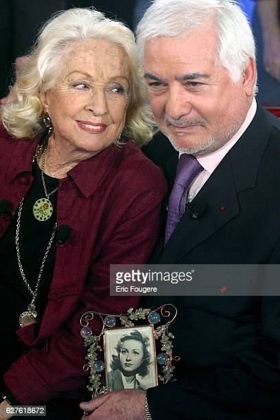 Danielle Darrieux sitting next to French actor JeanClaude Brialy is the special guest of 'Vivement Dimanche' presented by Michel Drucker