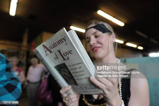 USA Danielle Dauphinee of Alive Theatre dons 1930s style clothing to help customers during Acres of Books' last hurrah in Long Beach CA on July 10...