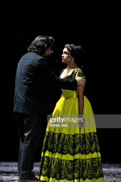 Danielle de Niese as Musetta and Etienne Dupuis as Marcello in the Royal Opera's production of Giacomo Puccini's La boheme directed by Richard Jones...