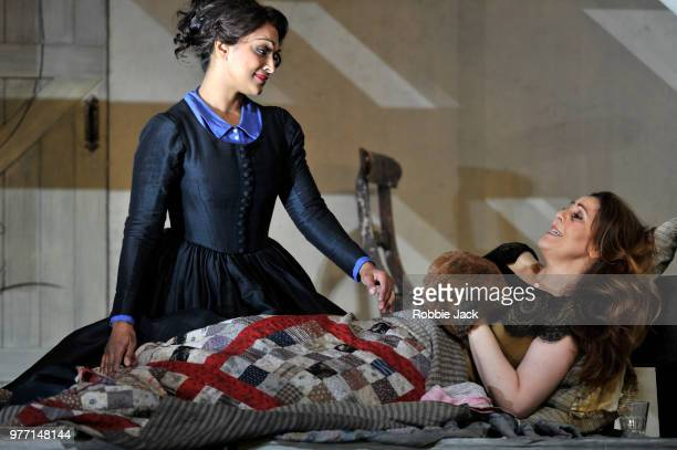 Danielle de Niese as Mussetta and Maria Agresta as Mimi in the Royal Opera's production of Giacomo Puccini's La Boheme directed by Richard Jones and...