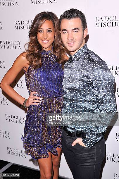 Danielle Deleasa and Kevin Jonas pose backstage at the Badgley Mischka show during the Spring 2013 MercedesBenz Fashion Week at The Theatre at...