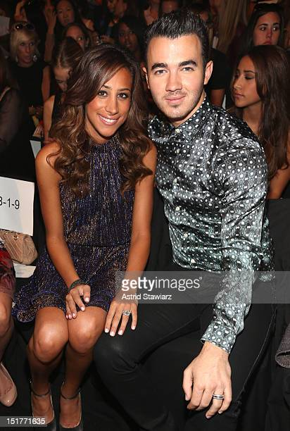 Danielle Deleasa and musician Kevin Jonas attend the Badgley Mischka Runway Show during the Spring 2013 MercedesBenz Fashion Week at The Theatre at...