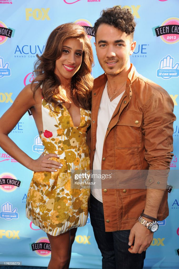 Danielle Deleasa and singer Kevin Jonas attend the 2013 Teen Choice Awards at Gibson Amphitheatre on August 11, 2013 in Universal City, California.