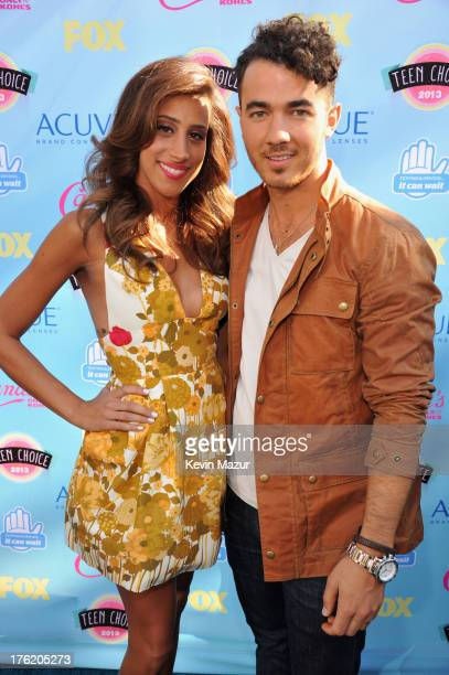 Danielle Deleasa and singer Kevin Jonas attend the 2013 Teen Choice Awards at Gibson Amphitheatre on August 11 2013 in Universal City California