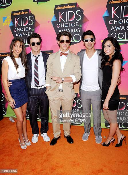 Danielle Deleasa singers Kevin Jonas Joe Jonas and Nick Jonas of the Jonas Brothers and actress Demi Lovato arrive at Nickelodeon's 23rd Annual Kids'...