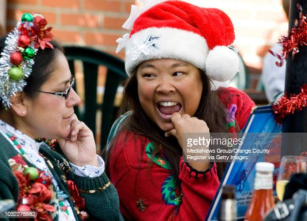 Danielle DeMoss at right laughs with Mary Ann Barnett left as they choose their breakfast at Longboards Restaurant Pub in dowtown Huntington Beach...