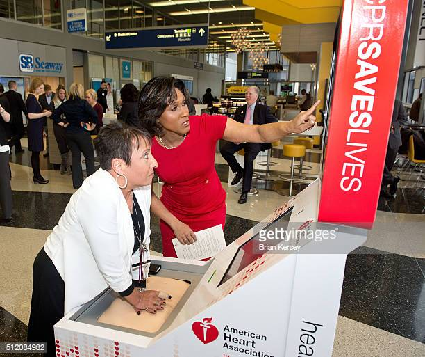 Danielle DeVito National American Heart Association Volunteer shows Lourdes A Rodriguez of Turnkey Training/Chicago Heartsave the HandsOnly CPR...