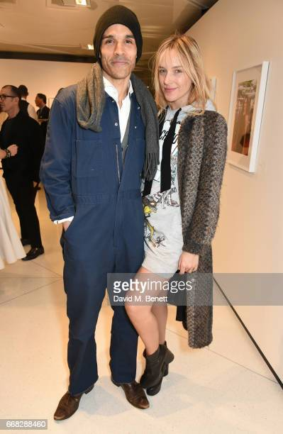 Danielle DuBoise and Damion Luaiye attend as Vogue Chopard open Glittering Prizes a photo exhibition by Ivan Shaw celebrating 70 years of the red...