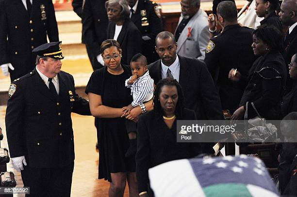Danielle Edwards stands during the funeral for her husband New York Police officer Omar Edwards who was killed in a friendly fire incident on May 28...