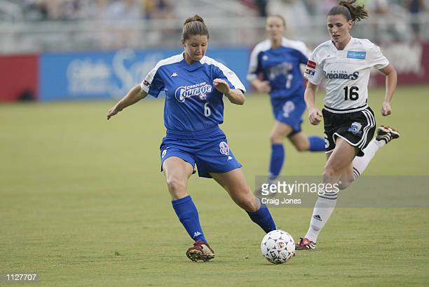 Danielle Fotopoulos of the Carolina Courage advances the ball against pressure from Christine McCann of the Boston Breakers during the WUSA game on...