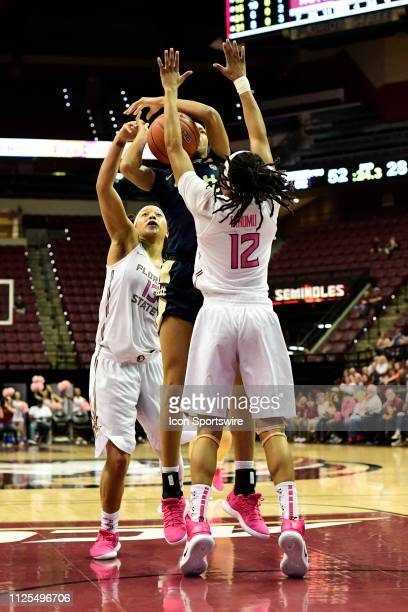 Danielle Garven forward University of Pittsburgh Panthers runs into a double-team of Nicki Ekhomu guard and Nausia Woolfolk guard Florida State...