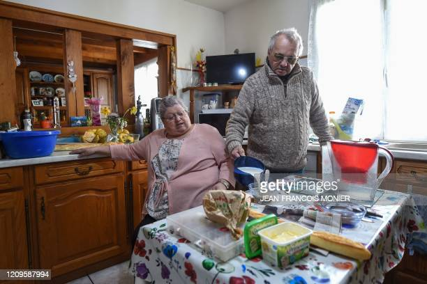 Danielle Gastebois and Henri Gastebois have lunch in their kitchen in Combres western France on April 8 on the 23rd day of a lockdown in France to...