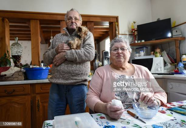 Danielle Gastebois and Henri Gastebois pose with their dog in their kitchen in Combres western France on April 8 on the 23rd day of a lockdown in...