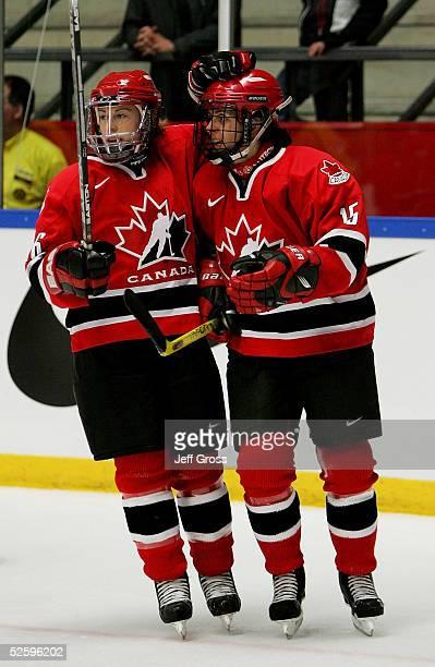 Danielle Goyette Jayna Hefford of team Canada celebrate a goal in first period against team Sweden in a IIHF World Women's Championships preliminary...