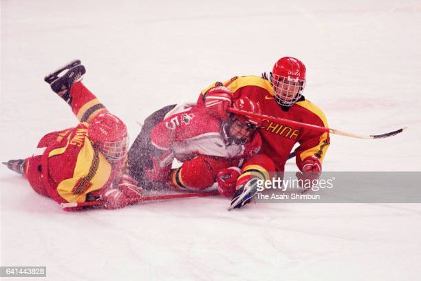 Danielle Goyette of Canada competes against Wang Wei and Li Xuan of China in the Ice Hockey Women's First round between Canada and China during day...