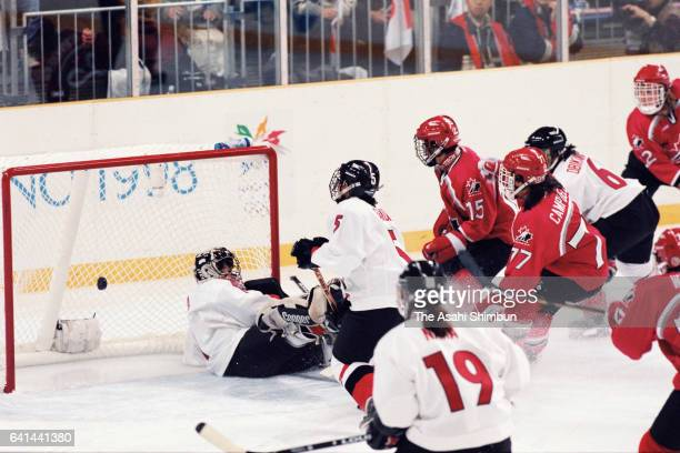 Danielle Goyette of Canada scores a goal in the first period during the Women's Ice Hockey first round match between Japan and Canada during day one...