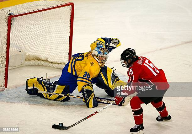 Danielle Goyette of Canada takes a shot on goal in front of goalie Kim Martin of Sweden during the final of the women's ice hockey during Day 10 of...