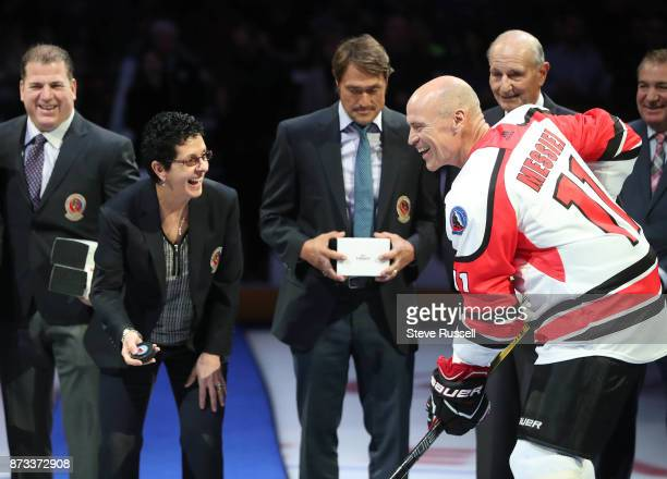 TORONTO ON NOVEMBER 12 Danielle Goyette smiles with Mark Messier before dropping the puck during the Hockey Hall of Fame Legends Classic at the Air...