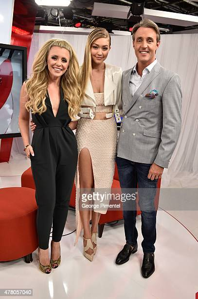 Danielle Graham Gigi Hadid and Ben Mulroney appears backstage in the eTalk Lounge at the 2015 MuchMusic Video Awards at MuchMusic HQ on June 21 2015...