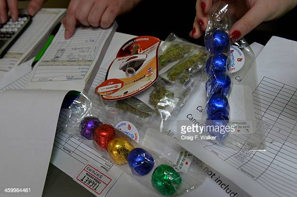 Danielle Hackett and Chantelle HackettSmith sell an assortment of marijuana products to a customer at BotanaCare 21 in Northglenn CO January 01 2014...