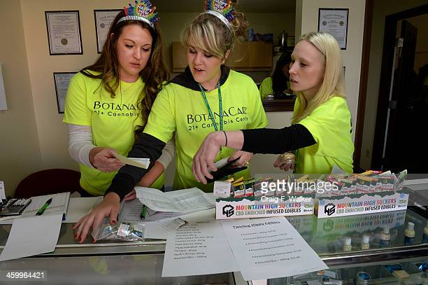 Danielle Hackett Chantelle HackettSmith and Abby McLean sell marijuana to a customer at BotanaCare 21 in Northglenn CO January 01 2014 The retail...