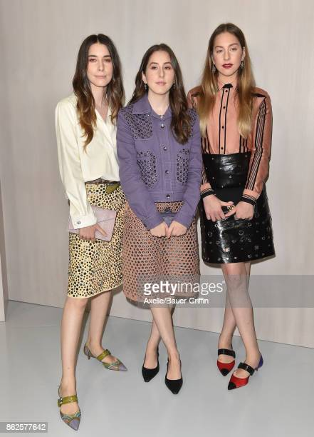 Danielle Haim Alana Haim and Este Haim of HAIM arrive at Hammer Museum Gala in the Garden on October 14 2017 in Westwood California