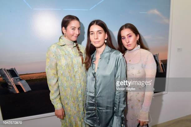 Danielle Haim Este Haim and Alana Haim from the band HAIM attend exhibition hosted by Acne Studios featuring Cindy Crawford Sam Abell and Amarrillo...