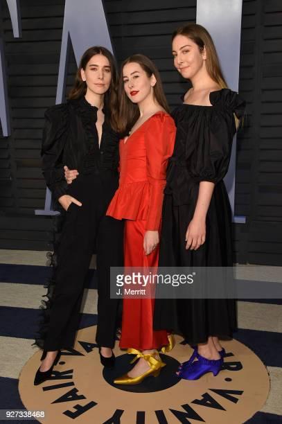 Danielle Haim Este Haim and Alana Haim of Haim attend the 2018 Vanity Fair Oscar Party hosted by Radhika Jones at the Wallis Annenberg Center for the...