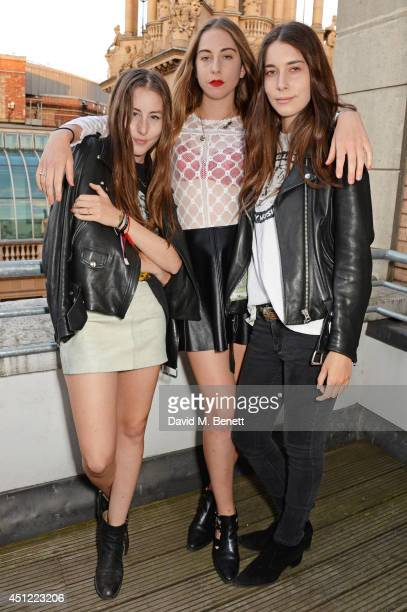 Danielle Haim Este Haim and Alana Haim of HAIM attend the grand opening of LIBRARY on June 25 2014 in London England