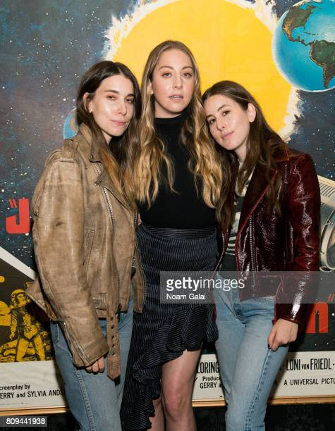 Danielle Haim Este Haim and Alana Haim of HAIM pose for a photo during a pop up screening of Paul Thomas Anderson's 'Valentine' at Alamo Drafthouse...