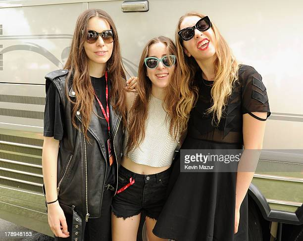 Danielle Haim Este Haim and Alana Haim of the band Haim pose backstage during the 2013 Budweiser Made In America Festival at Benjamin Franklin...