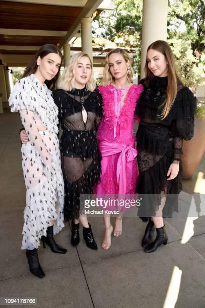 Danielle Haim Este Haim Brie Larson and Alana Haim attend JNSQ Rose Cru debuts alongside Rodarte FW/19 Runway Show at Huntington Library on February...