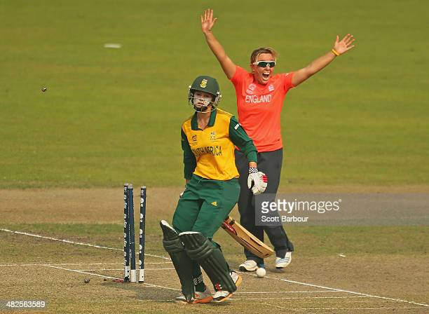 Danielle Hazell of England celebrates as Dane van Niekerk of South Africa is run out during the ICC Women's World Twenty20 Bangladesh 2014 2nd...