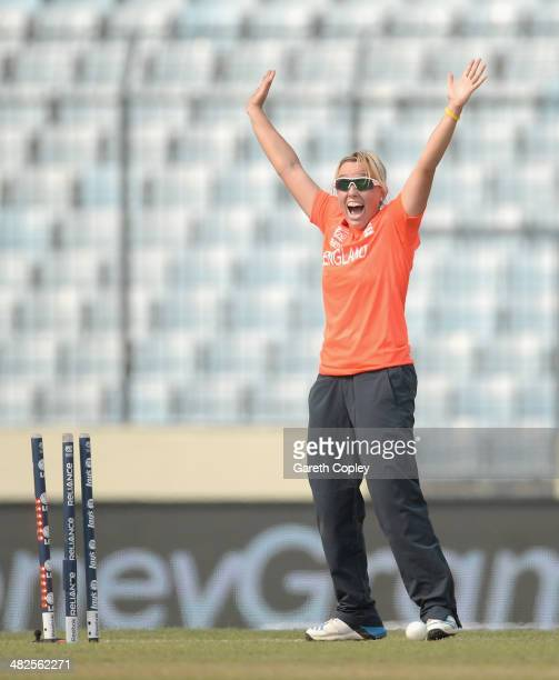 Danielle Hazell of England celebrates running out Dane van Niekerk of South Africa during the ICC Womens World Twenty20 Bangladesh 2014 semi final...