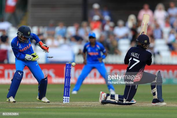 Danielle Hazell of England is bowled out during the England v India group stage match at the ICC Women's World Cup 2017 at The 3aaa County Ground on...