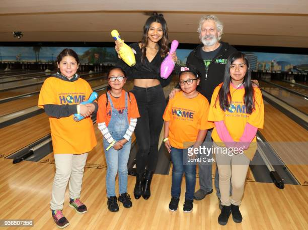 Danielle Herrington and A Place Called Homes Executive Director Jonathan Zeichner pose with kids at A Place Called Home's 12th Annual Stars Strikes...