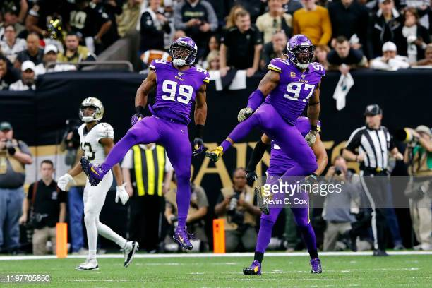 Danielle Hunter and Everson Griffen of the Minnesota Vikings celebrate during the first half against the New Orleans Saints in the NFC Wild Card...