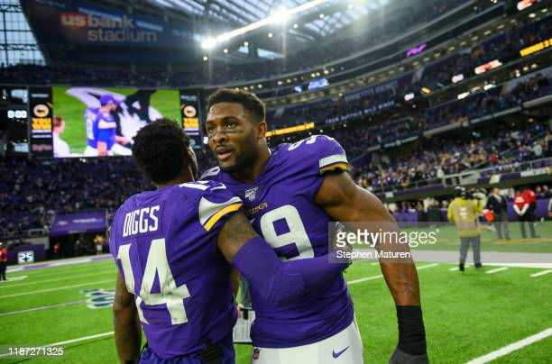 Danielle Hunter of the Minnesota Vikings and Stefon Diggs of the Minnesota Vikings greet each other after the game against the Detroit Lions at US...