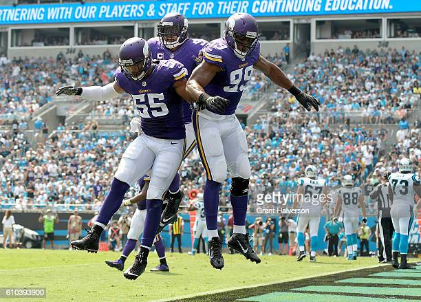 Danielle Hunter of the Minnesota Vikings celebrates with teammates after sacking Cam Newton of the Carolina Panthers for a safety during the game at...