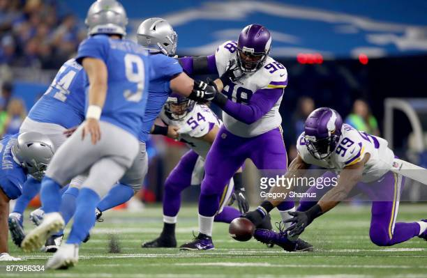 Danielle Hunter of the Minnesota Vikings recovers a fumble by quarterback Matthew Stafford of the Detroit Lions during the first half at Ford Field...