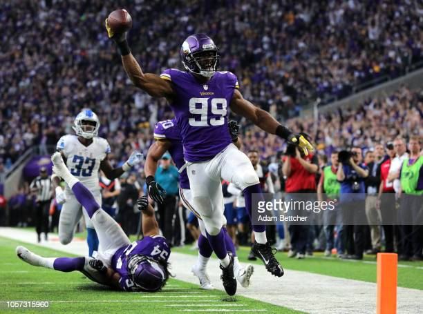 Danielle Hunter of the Minnesota Vikings scores a touchdown after recovering a fumble in the fourth quarter of the game against the Detroit Lions at...