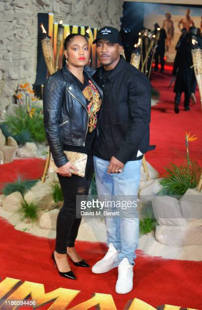 Danielle Isaie and Ashley Walters attend the UK Premiere of Jumanji The Next Level at Odeon IMAX Waterloo on December 5 2019 in London England