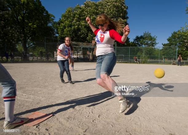 Danielle Jacobs tries to hit baserunner Chanda McCool as she scampers to 2nd base during some infield action Members of a Toronto kickball league...