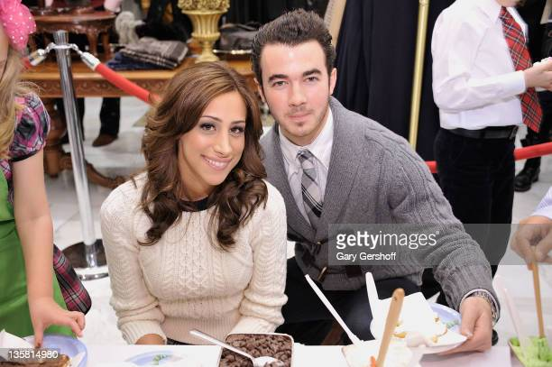 Danielle Jonas and Kevin Jonas attend the sixth annual holiday celebration to benefit St Jude Children's Hospital hosted by Brooks Brothers at Brooks...