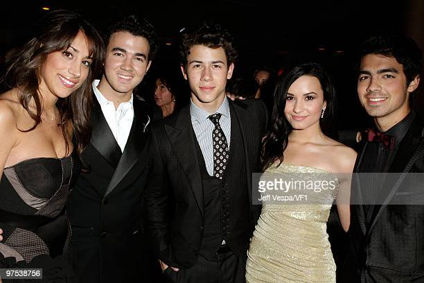 WEST HOLLYWOOD CA MARCH 07 *EXCLUSIVE* Danielle Jonas and musicians Kevin Jonas Nick Jonas Demi Lovato and Joe Jonas attend the 2010 Vanity Fair...